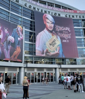Posters hang outside the Anaheim Convention Center highlighting the new season of Escape the Night, a show on YouTube, in Anaheim