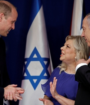 Britain's Prince William speaks with Israeli Prime Minister Benjamin Netanyahu and his wife Sara during a meeting at the prime minister's residence in Jerusalem