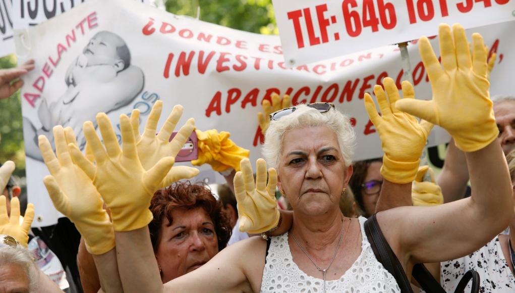 People take part in a protest against Spain stolen babies scandal outside Spanish court in Madrid