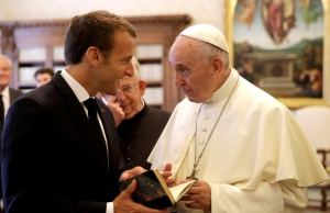 Pope Francis exchanges gifts with French President Emmanuel Macron during private audience at the Vatican