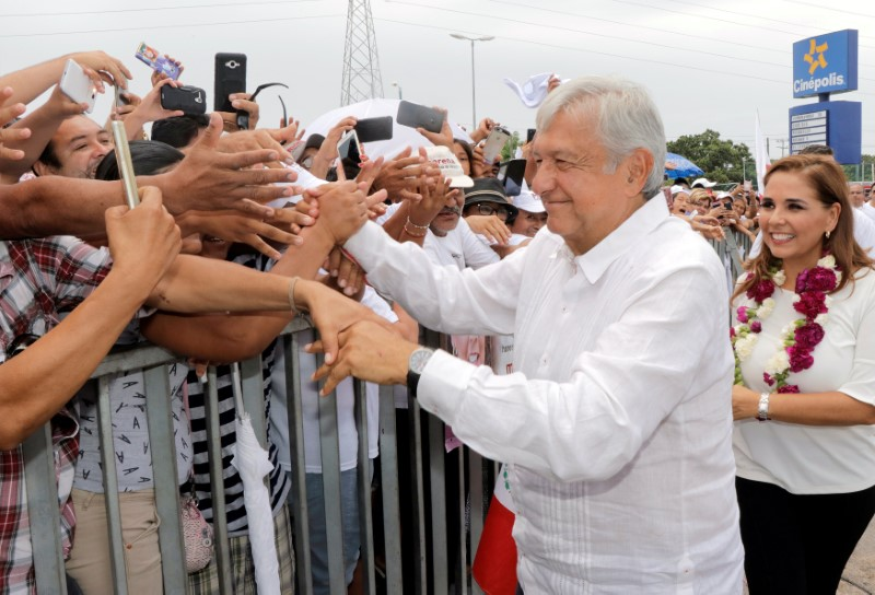 Mexican presidential candidate Andres Manuel Lopez Obrador greets supporters during a campaign rally, in Cancun