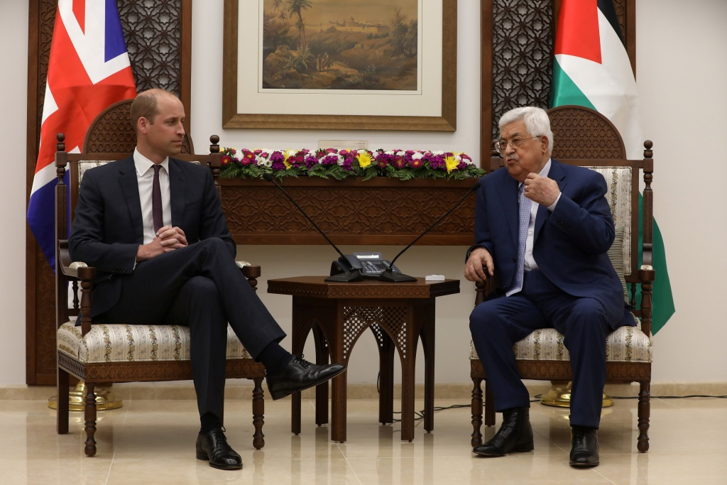 Palestinian President Mahmoud Abbas gestures during his meeting with Britain's Prince William in Ramallah, in the occupied West Bank