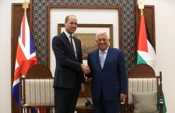 Palestinian President Mahmoud Abbas shakes hands with Britain's Prince William during their meeting in Ramallah, in the occupied West Bank