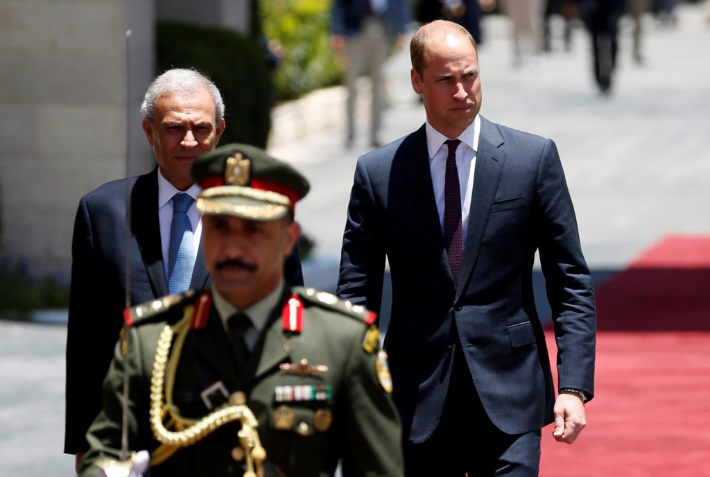 Britain's Prince William reviews the honor guard during a reception ceremony in Ramallah, in the occupied West Bank
