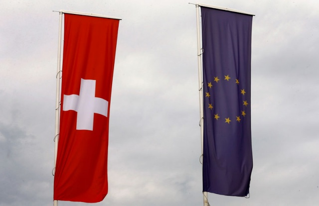 Flags of the European Union and Switzerland flutter in the wind in Blotzheim