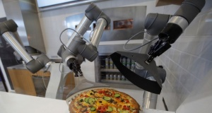 A pizzaiolo robot prepares a pizza before the customer's eyes at the showroom of French food startup EKIM in Montevrain near Paris