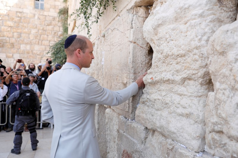 Britain's Prince William touches the Western Wall, Judaism's holiest prayer site, in Jerusalem's Old City