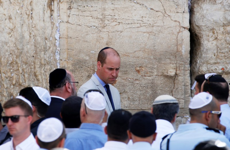 Britain's Prince William stands next to the Western Wall, Judaism's holiest prayer site, in Jerusalem's Old City