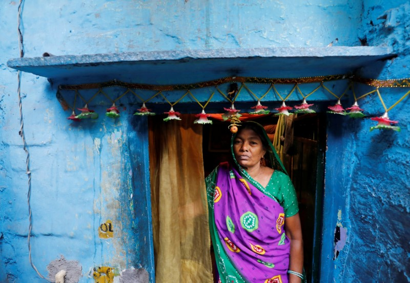 Sushila Devi, whose husband and son died after a brawl with neighbours over water in March, stands outside her house in New Delhi