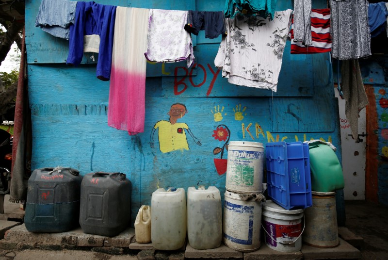 Water containers are pictured outside a house in New Delhi