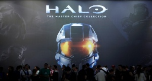 "Vistors wait at the ""Halo: The Master Chief Collection"" exhibition stand during the Gamescom 2014 fair in Cologne"