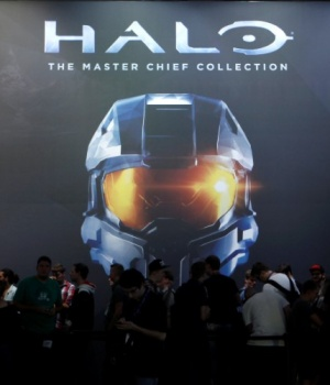 """Vistors wait at the """"Halo: The Master Chief Collection"""" exhibition stand during the Gamescom 2014 fair in Cologne"""