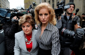 Summer Zervos, a former contestant on The Apprentice, leaves New York State Supreme Court with attorney Gloria Allred, after a hearing on the defamation case