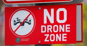 A sign at a downtown city park informs people the area is a no drone zone