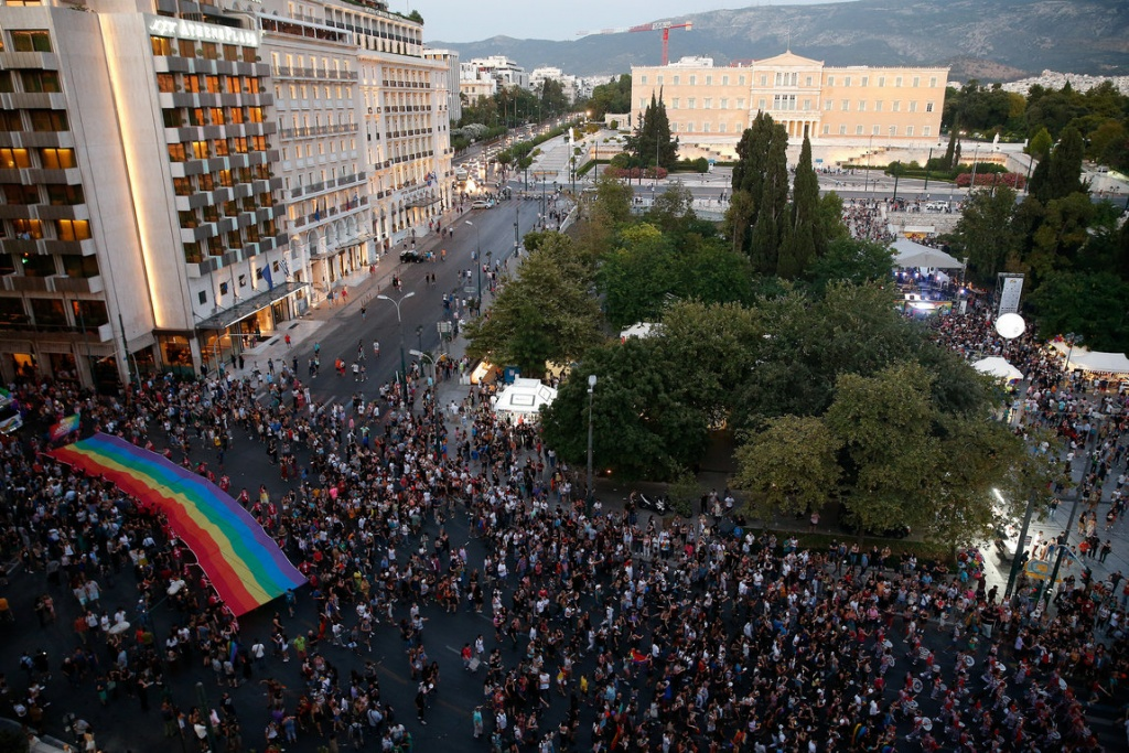 A rainbow flag is seen in front of the Parliament building during a Gay Pride parade in Athens