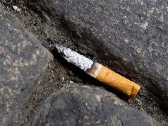 A cigarette butt litters the street in Lyon