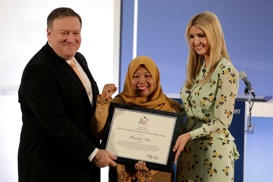 .S. Secretary of State Mike Pompeo and White House senior advisor Ivanka Trump award Maizidah Salas, migrant worker from Indonesia, during an event to unveil the 2018 Trafficking in Persons (TIP) Report at the State Department in Washington