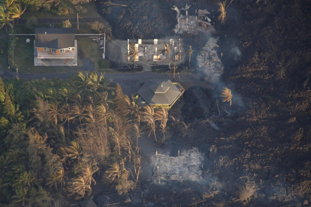 Lava destroys homes in the Kapoho area, east of Pahoa, during ongoing eruptions of the Kilauea Volcano