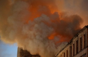 Firefighters attend to a blaze at the Mackintosh Building at the Glasgow School of Art, which is the second time in four years