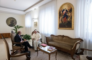 Pope Francis listens to reporter question during an exclusive interview with Reuters at the Vatican
