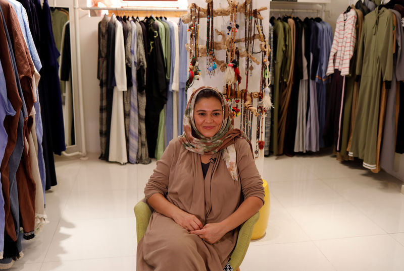 Eman Joharjy, a fashion designer sits during an interview with Reuters journalists at her shop in Jeddah,