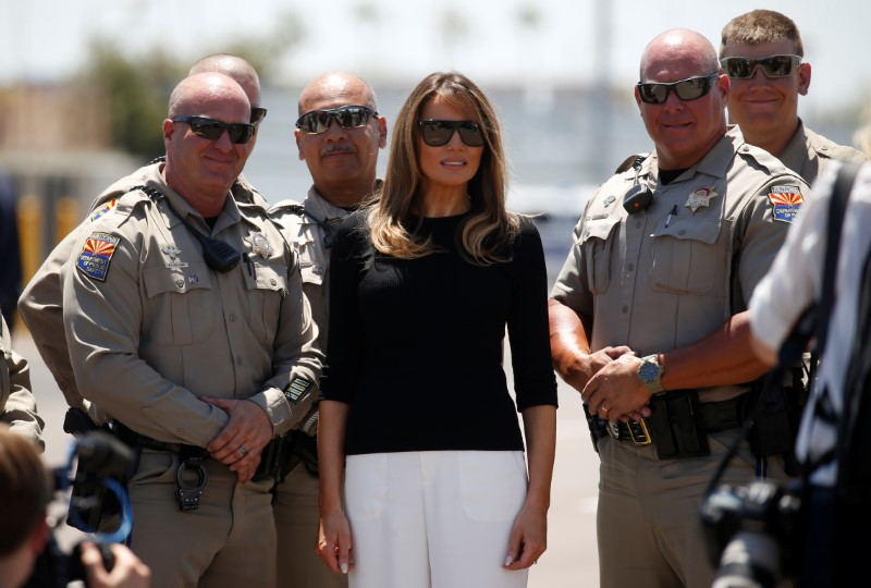 U.S. first lady Melania Trump poses with local law enforcement after touring immigration detention facility for children in Phoenix, Arizona