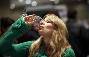 A woman drinks a sample of red wine at the New York Wine Expo