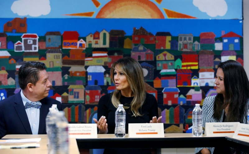 U.S. first lady Melania Trump talks with attendees at roundtable discussion at immigration detention facility for children in Phoenix, Arizona
