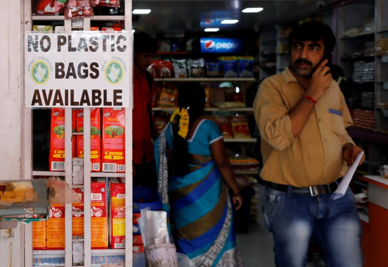 A notice is pasted outside a shop stating the unavailability of plastic bags at a market in Mumbai