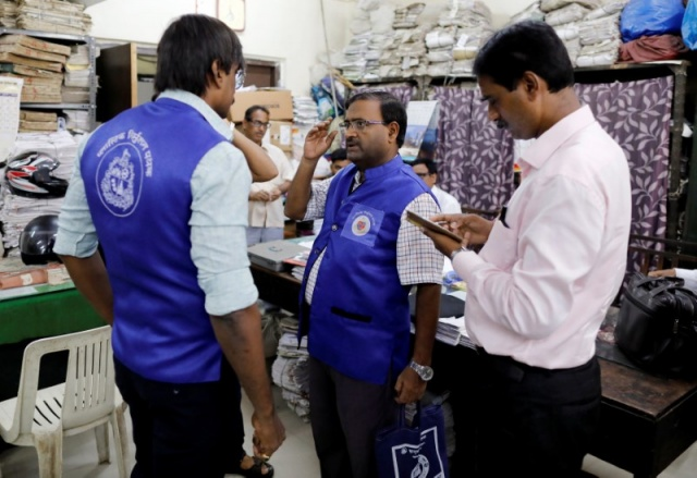 Municipal officers prepare to leave from their office in Mumbai