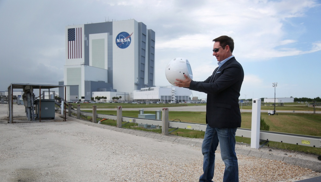 Bret Greenstein of IBM holds an artificial intelligence bot named CIMON, following a news conference at the Kennedy Space Center in Florida