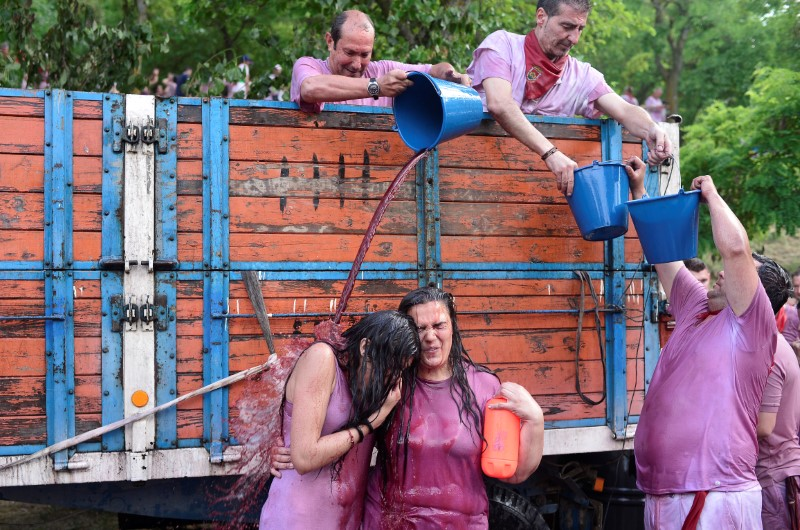 Revellers have wine poured over them during the Batalla de Vino (Wine Battle) in Haro