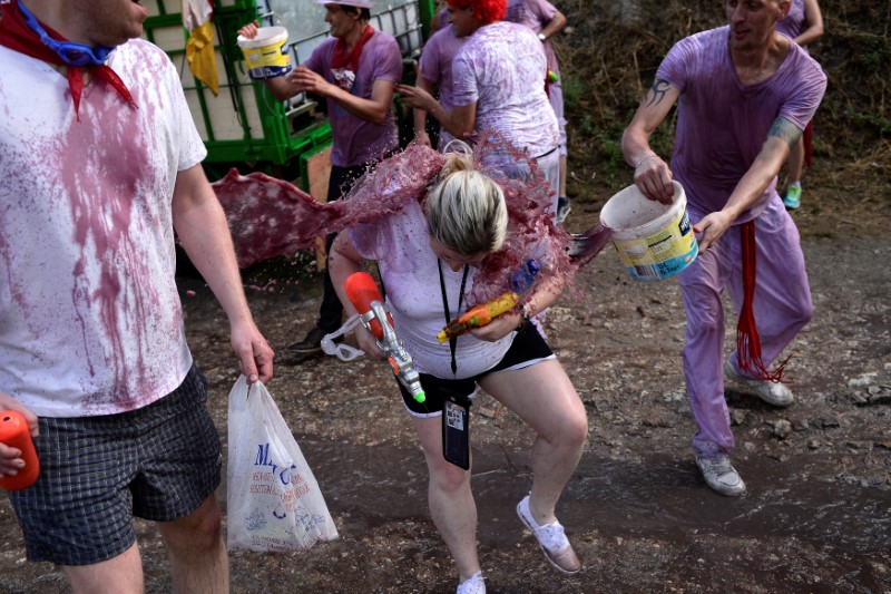 A reveller has wine thrown at her during the Batalla de Vino (Wine Battle) in Haro