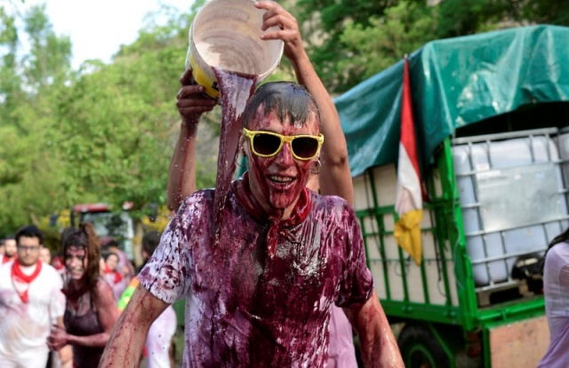 A reveller has wine poured over him during the Batalla de Vino (Wine Battle) in Haro