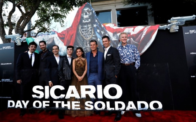 Cast members pose at the premiere for the movie