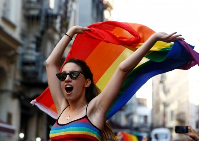 A member of LGBT community takes part in a Gay Pride parade in central Istanbul