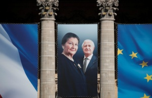 Late Auschwitz survivor and French health minister Simone Veil and her late husband Antoine Veil appear on a giant banner on the Pantheon in Paris