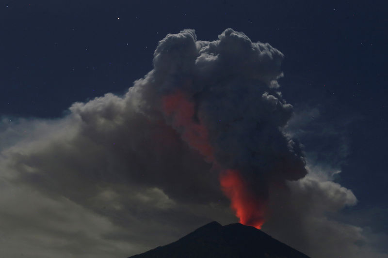 Mount Agung volcano erupts during the night, as seen from Datah village, Karangasem Regency in Bali