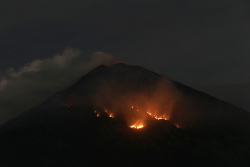 Fire is seen on the slopes of Mount Agung volcano following an eruption as seen from Amed in Karangasem Regency, Bali, Indonesia