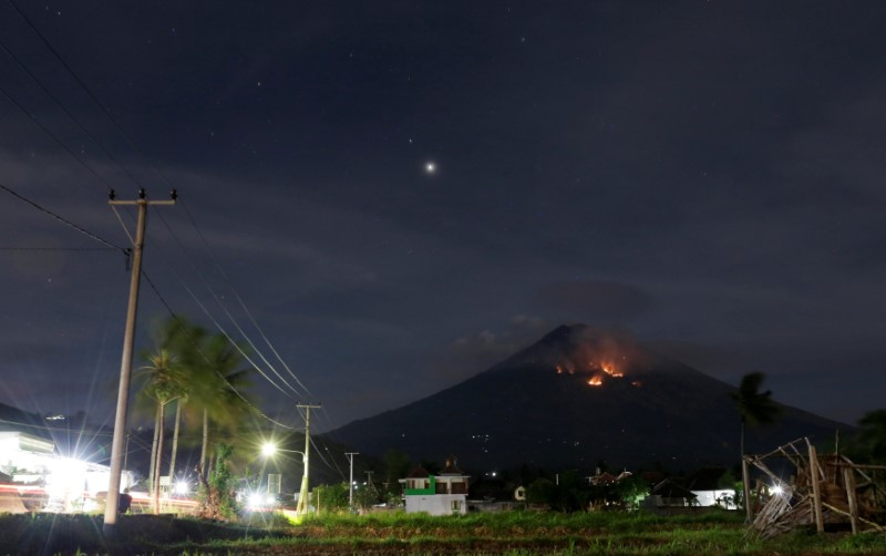 Fire is seen on the slopes of Mount Agung volcano following an eruption as seen from Amed in Karangasem Regency, Bali