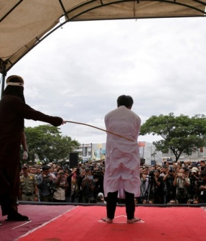 An Indonesian man is publicly caned for having gay sex in Banda Aceh