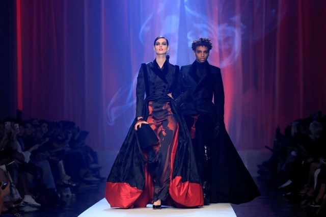 Models present creations by French designer Jean Paul Gaultier as part of his Haute Couture Fall/Winter 2018/2019 collection show in Paris