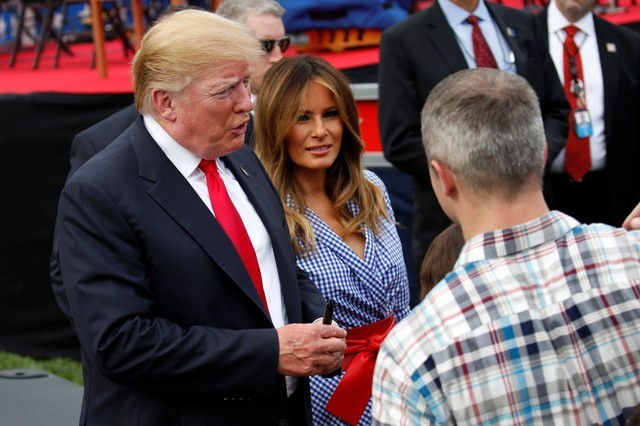 U.S. President Donald Trump and U.S. first lady Melania Trump greet people during a picnic for military families celebrating Independence Day at the White House in Washington