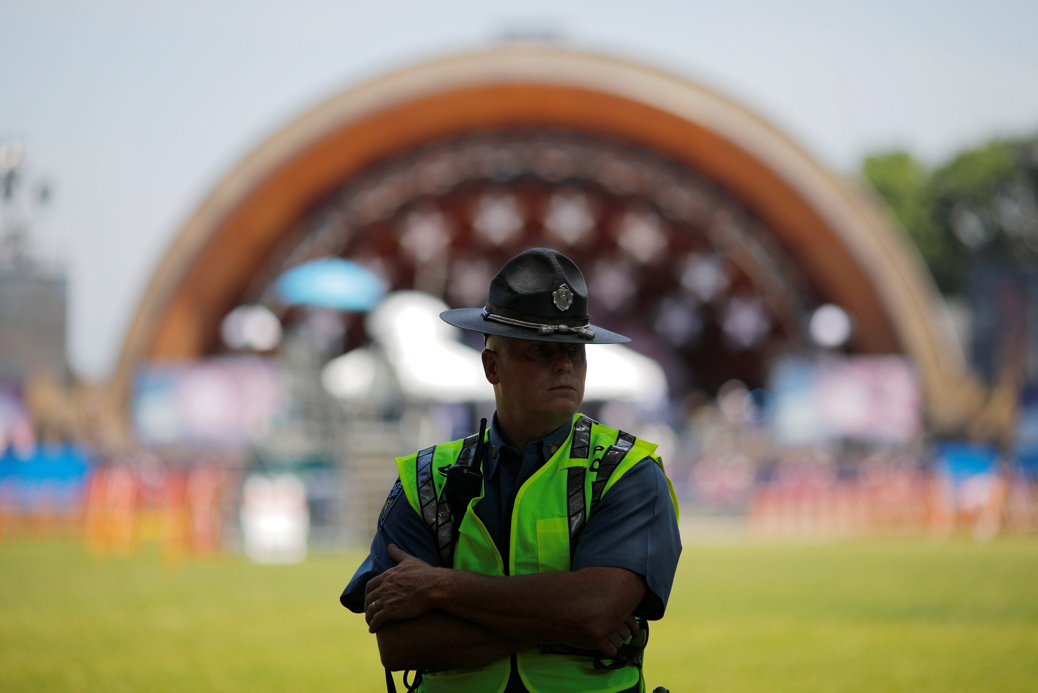 A Massachusetts State Police trooper stands at the Hatch Shell ahead of Fourth of July festivities in Boston