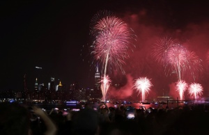 People gather to watch fireworks at the East River State Park in Williamsburg, Brooklyn to celebrate Independence Day in New York City, U.S.
