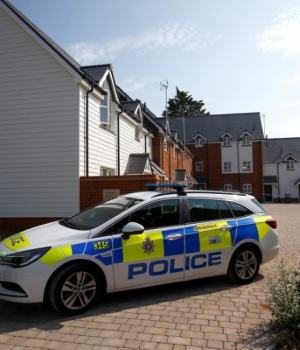 Police officers guard the entrance to a housing estate on Muggleton Road, after it was confirmed that two people had been poisoned with the nerve-agent Novichok, in Amesbury