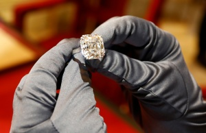 An employee presents a high jewellery diamond ring from the Red Carpet 2018 Collection at the luxury jeweller Chopard store in Paris