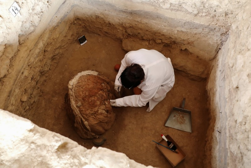 An archaeologist works during unearthing of tombs and human remains from the Inca culture at Huaca de las Abejas, in Tucume Archaeological Complex in Lambayeque