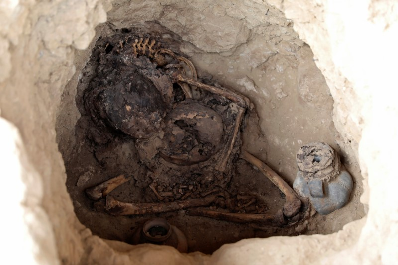 Human remains and pottery from the Inca culture are seen inside a tomb at Huaca de las Abejas, in Tucume Archaeological Complex in Lambayeque
