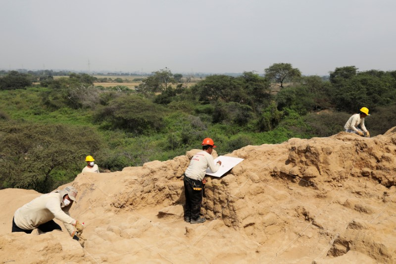 Archaeologists work at Huaca de las Abejas, tombs from the Inca culture, in Tucume Archaeological Complex in Lambayeque